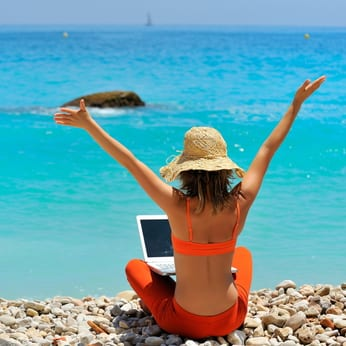 Woman on the beach with her laptop
