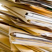 A pile of manilla folders stacked on top of each other