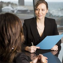 Two women in interview situation - white collar office