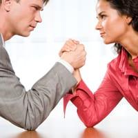 Man versus woman in arm wrestle