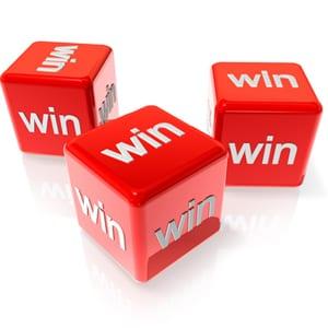 three dice saying win