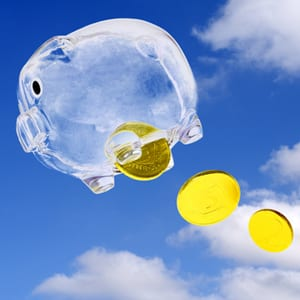 Piggy bank flying through the sky, dropping coins