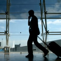business traveller on mobile phone