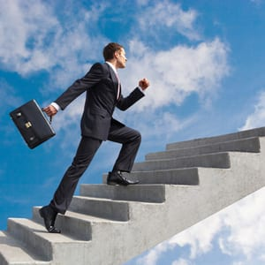 business leader walking up a flight of stairs