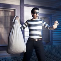 Thief holding up a bag of loot