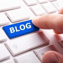 Man typing blog on a keyboard