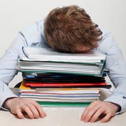 Employee asleep at his desk