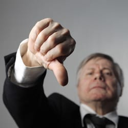 Business man giving a thumbs down