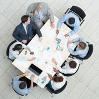 People sitting around a table, having a meeting