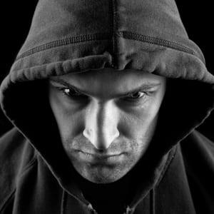 criminal wearing hood