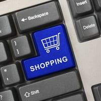 Blue shopping trolley on keyboard