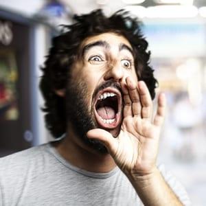 Man yelling loudly