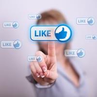 Woman pressing 'Like' on social media button