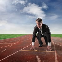 Business man crouching to start a race