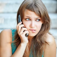 anxious woman on mobile phone