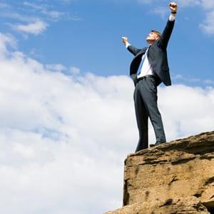 Man celebrating business success