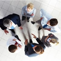 employees talking in a circle