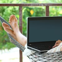 Lady working from home on a hammock