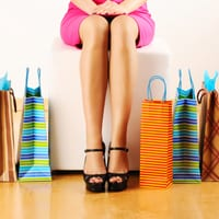 Woman sitting down with her shopping bags