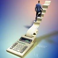 Businessman climbing a calculator sheet