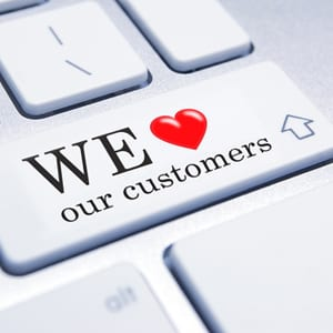 we love our customers computer button