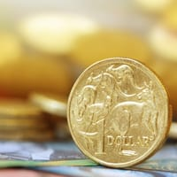 Australian one dollar coin standing on its edge