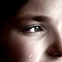 Little girl with a tear on her cheek
