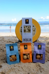 Byron Bay Cookie Company products on the beach