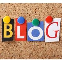 """blog"" pinned up on corkboard"