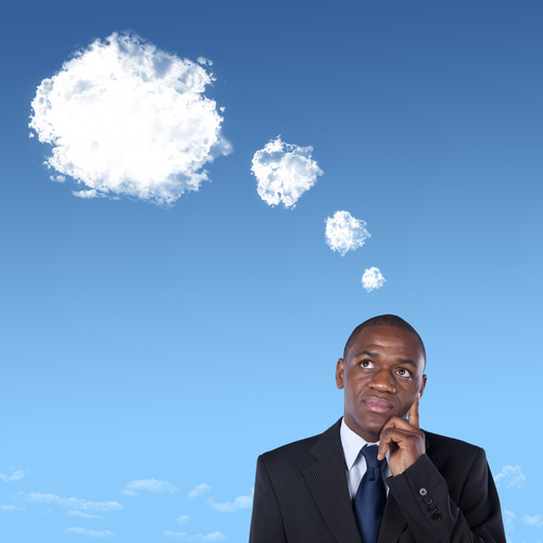 business man with clouds above his head