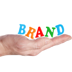 """Woman's hand with """"Brand"""" sitting in the palm"""