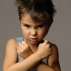 boy with arms crossed in front of him