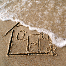 Drawing of house in sand being washed away