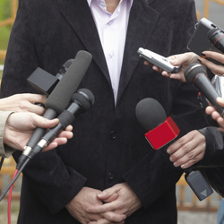 Businessman being interviewed by the media