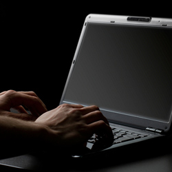 man typing on a computer