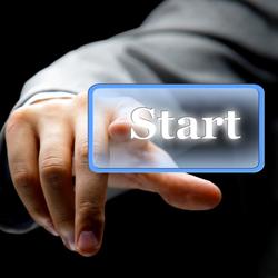 Man pressing a start button