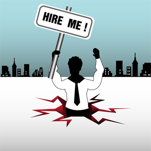 Job candidate holding 'hire-me' sign