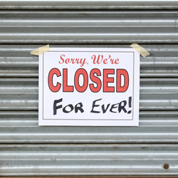 Closed sign, hung on garage sign