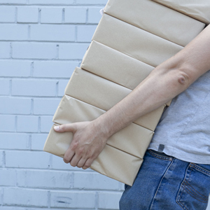 Man carrying pile of boxes