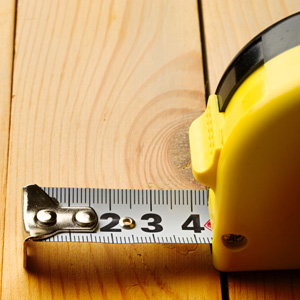 Measuring tape on wooden bench