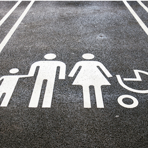 Parking spot, with silhouette of parents, child and pram