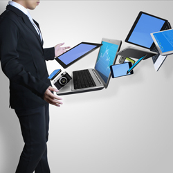 Man with various business technologies in front of him