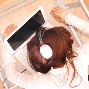 Woman asleep on her computer