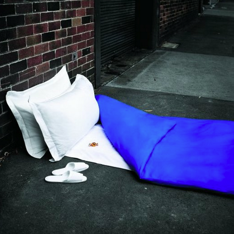 Sleeping bag with cushions, on the street
