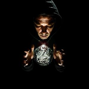 Man gazing into crystal ball