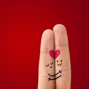 Two painted fingers representing a couple in love