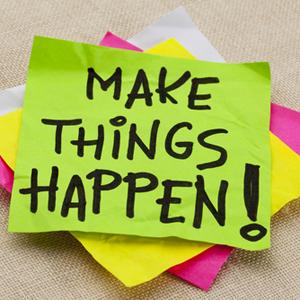 """""""Make things happen"""" written on a post-it"""
