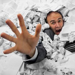 man buried in paperwork