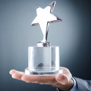 Award winner holding business trophy