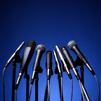 Stand of microphones on blue background